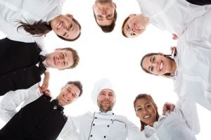 Waiters and waitresses standing in circle